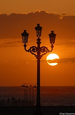 Spain, Andalusia, Cadiz, sky, red clouds, sunset, street lamp