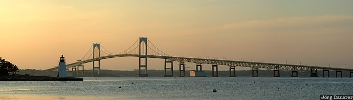RI, Newport Harbor, Goat Island, lighthouse, Newport, Newport Bridge, evening light