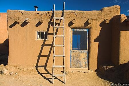 Adobe building adobe blue sky clouds door el prado for Building an adobe house